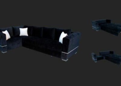 Tamnoplava ugaona garnitura sa belim jastucima i prikazom kako izgleda kada se razvuče