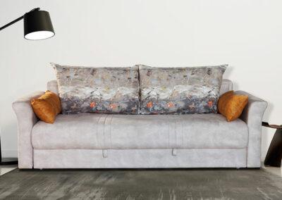 Moderan sivi kauč na razvlačenje sa narandžastim jastucima